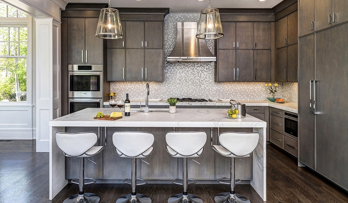 transitional design in kitchen in traditional home by Cardello Architects