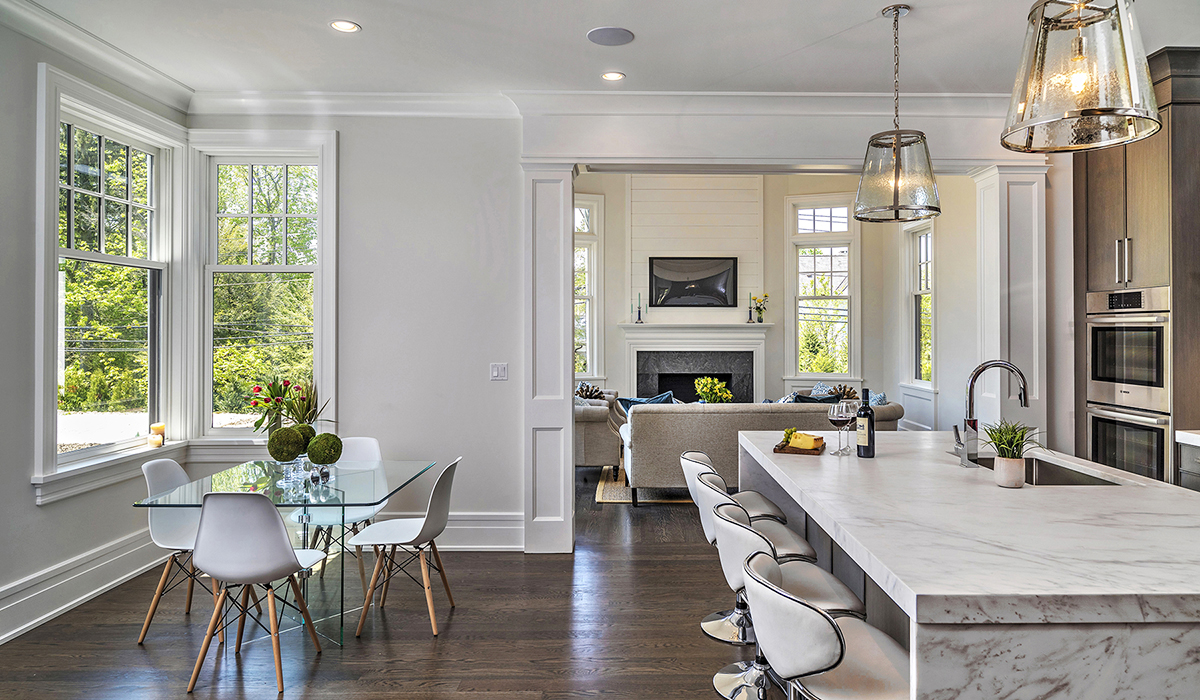 open floor plan kitchen dining room in shingle style residence by Cardello Architects