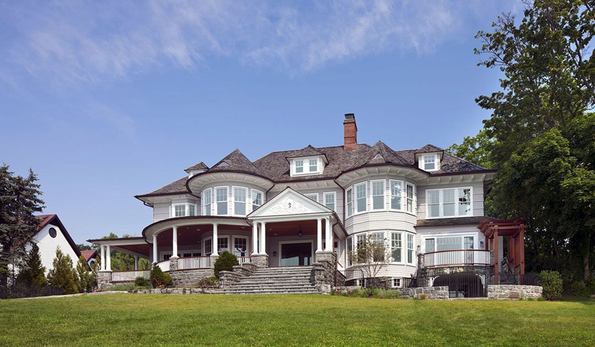 Custom home design by luxury waterfront architect for shingle style home