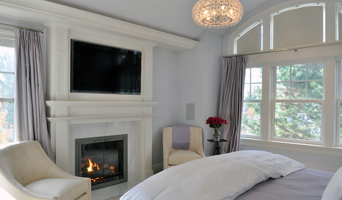 new england cottage with master bedroom and fireplace