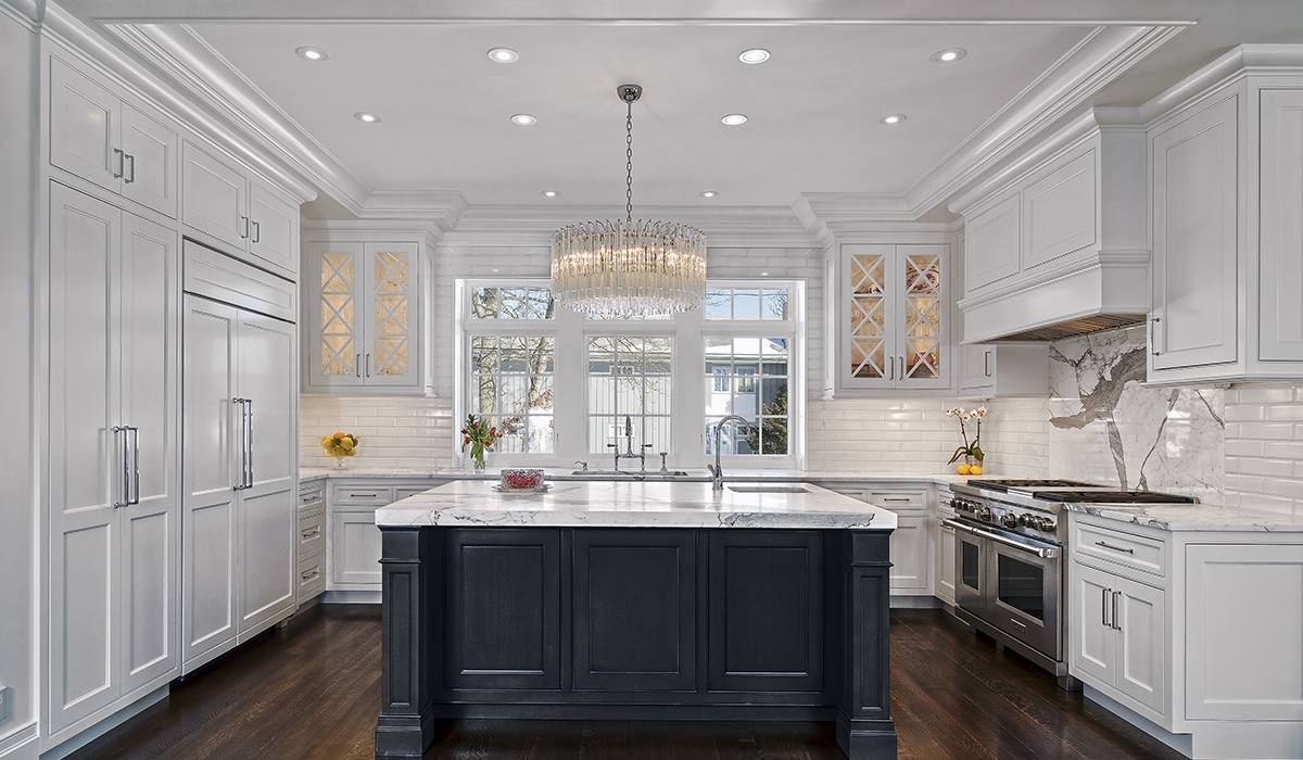 traditional kitchen in shingle style home with black island by cardello architects