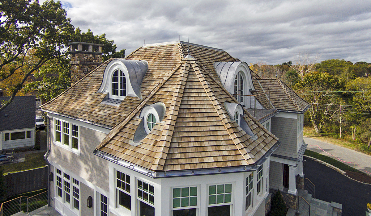 traditional shingel style home with cedar roof by cardello architects