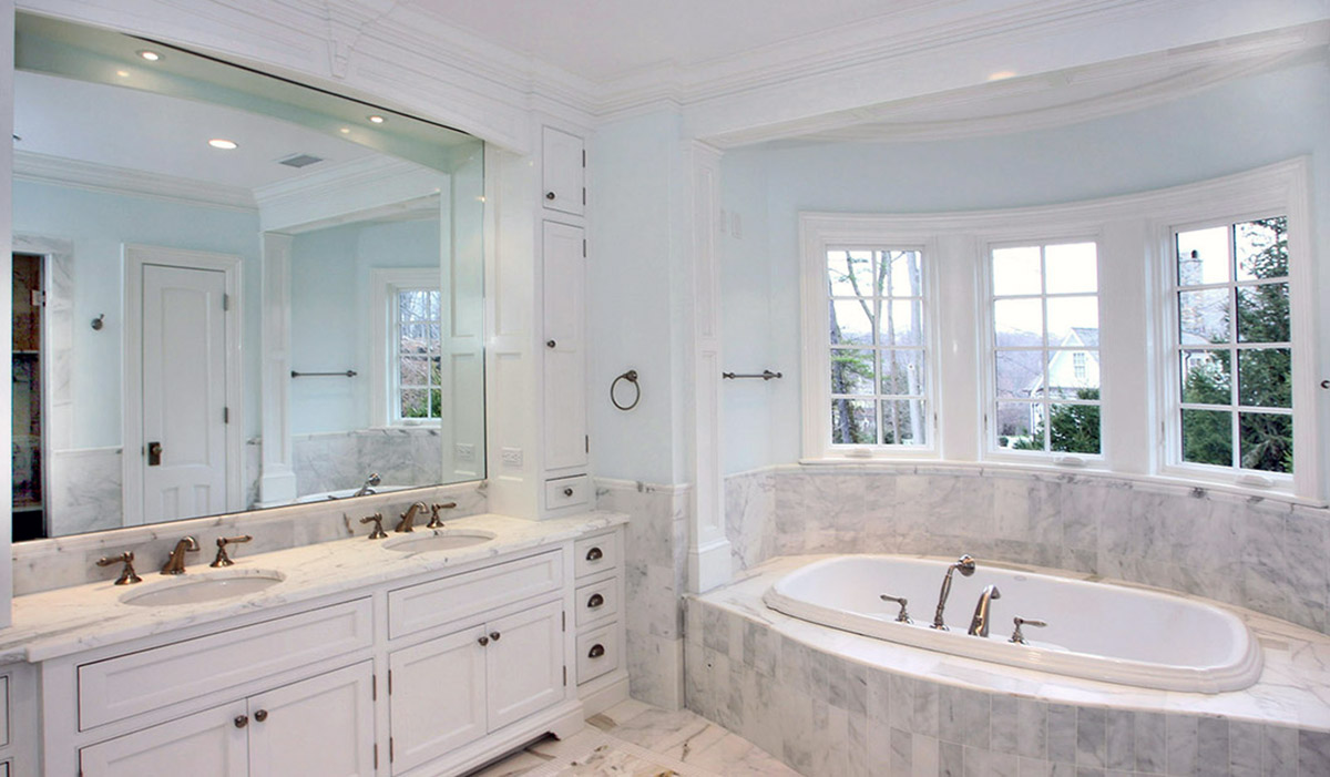 CUstom DArien Connecticut master bathroom with soaking tub and large vanity by cardello architects