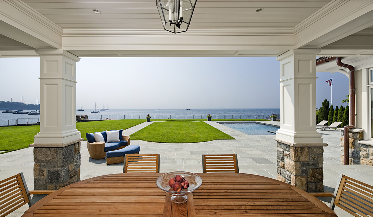 Covered terrace of luxury waterfront home