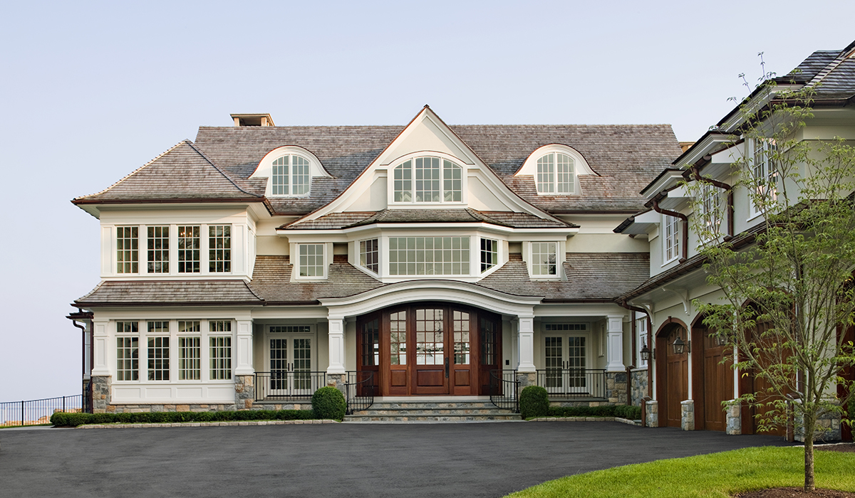 Front entry drive court of luxury residence in Darien, Connecticut