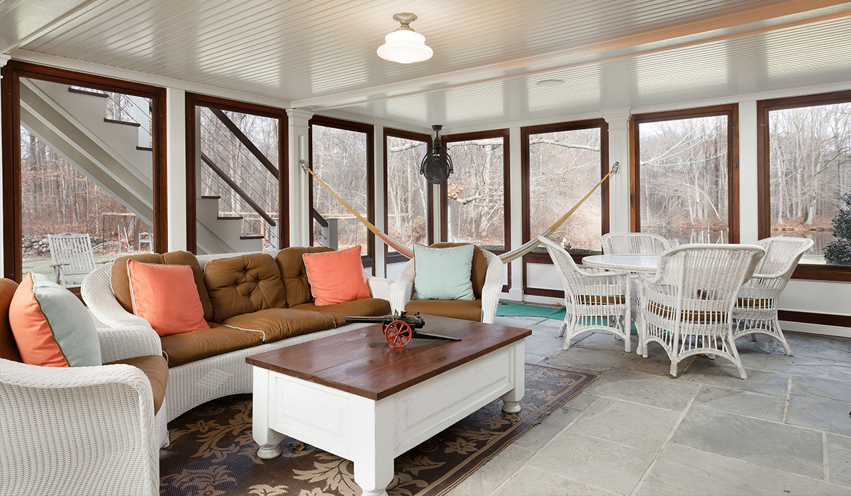 Fairfield Connecticut traditional style home renovation on the water four season sunroom