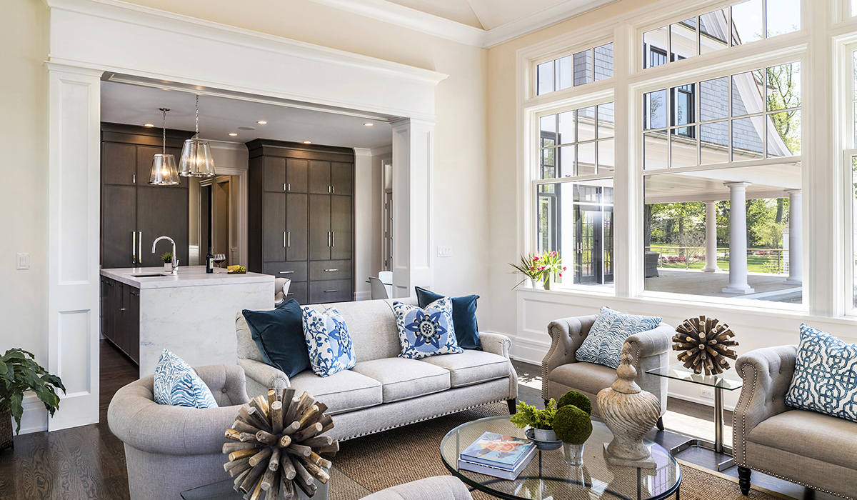 living room in custom luxury shingle style home window transom by Cardello Architects