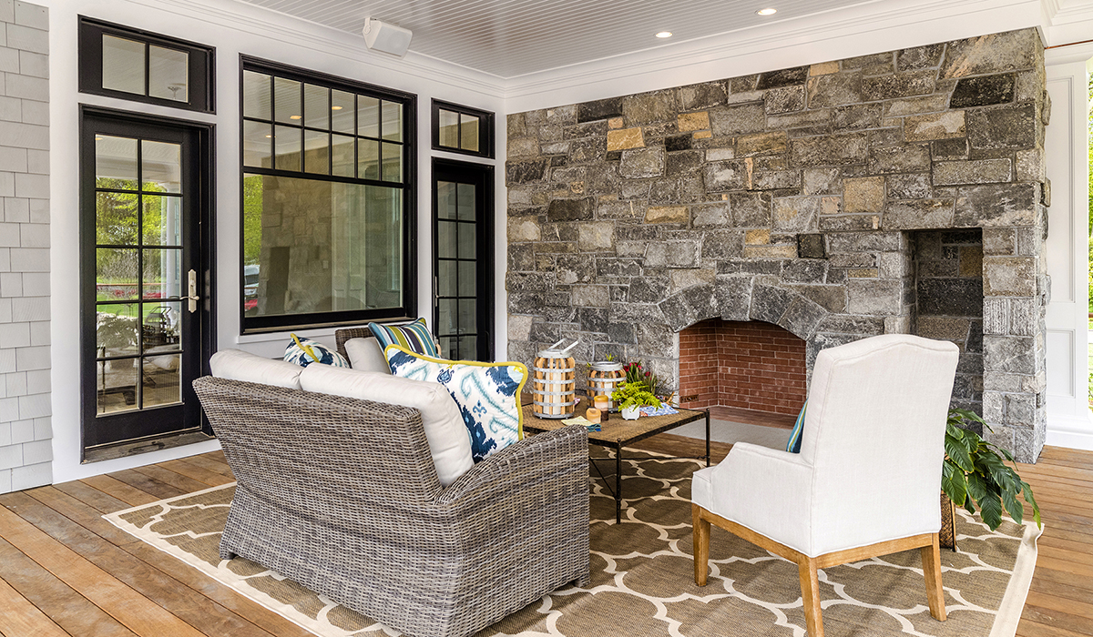 SCreen porch with fireplace in luxury screen porch by Cardello Architects