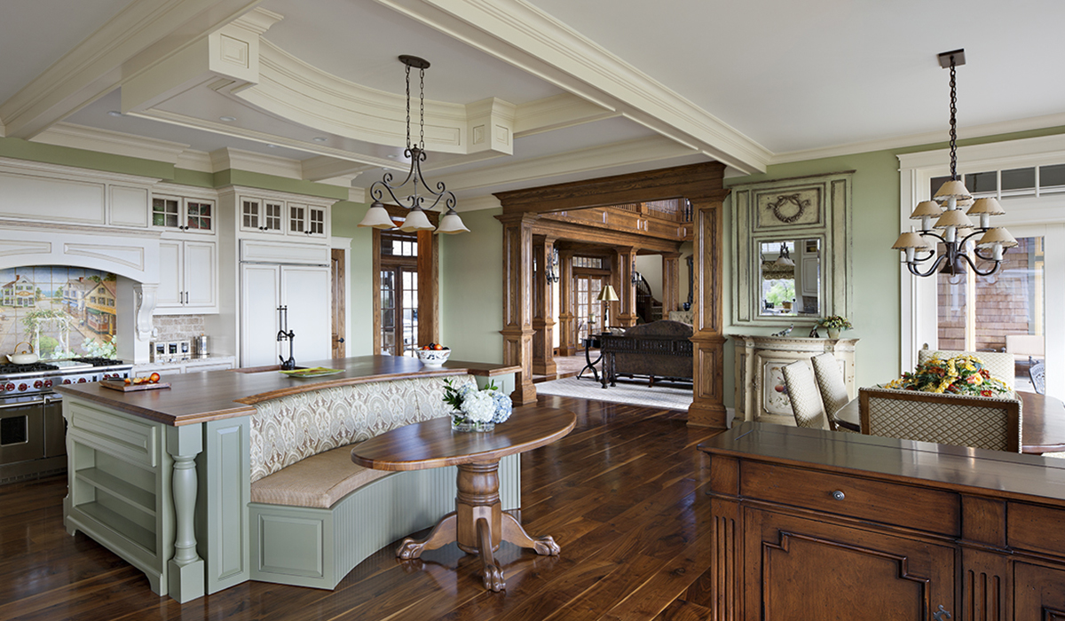 Kitchen banquette and large island in waterfront home