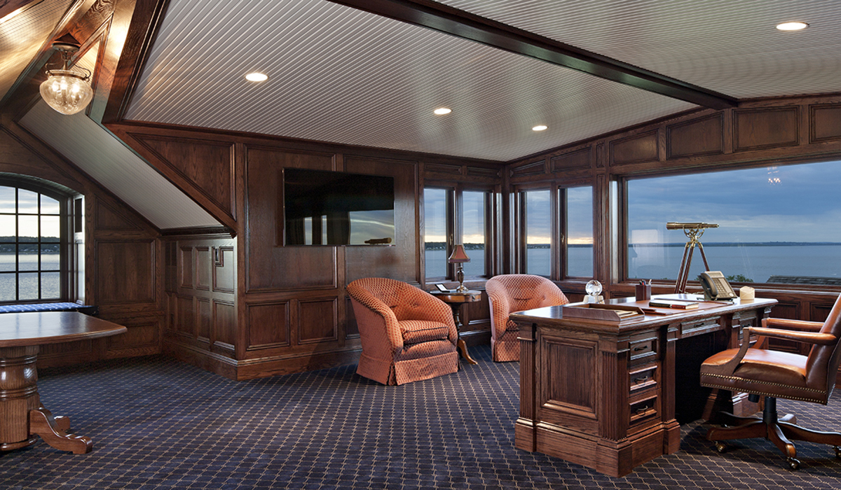 luxury home office with walnut paneling in attic of Portsmouth Rhode Island waterfront home