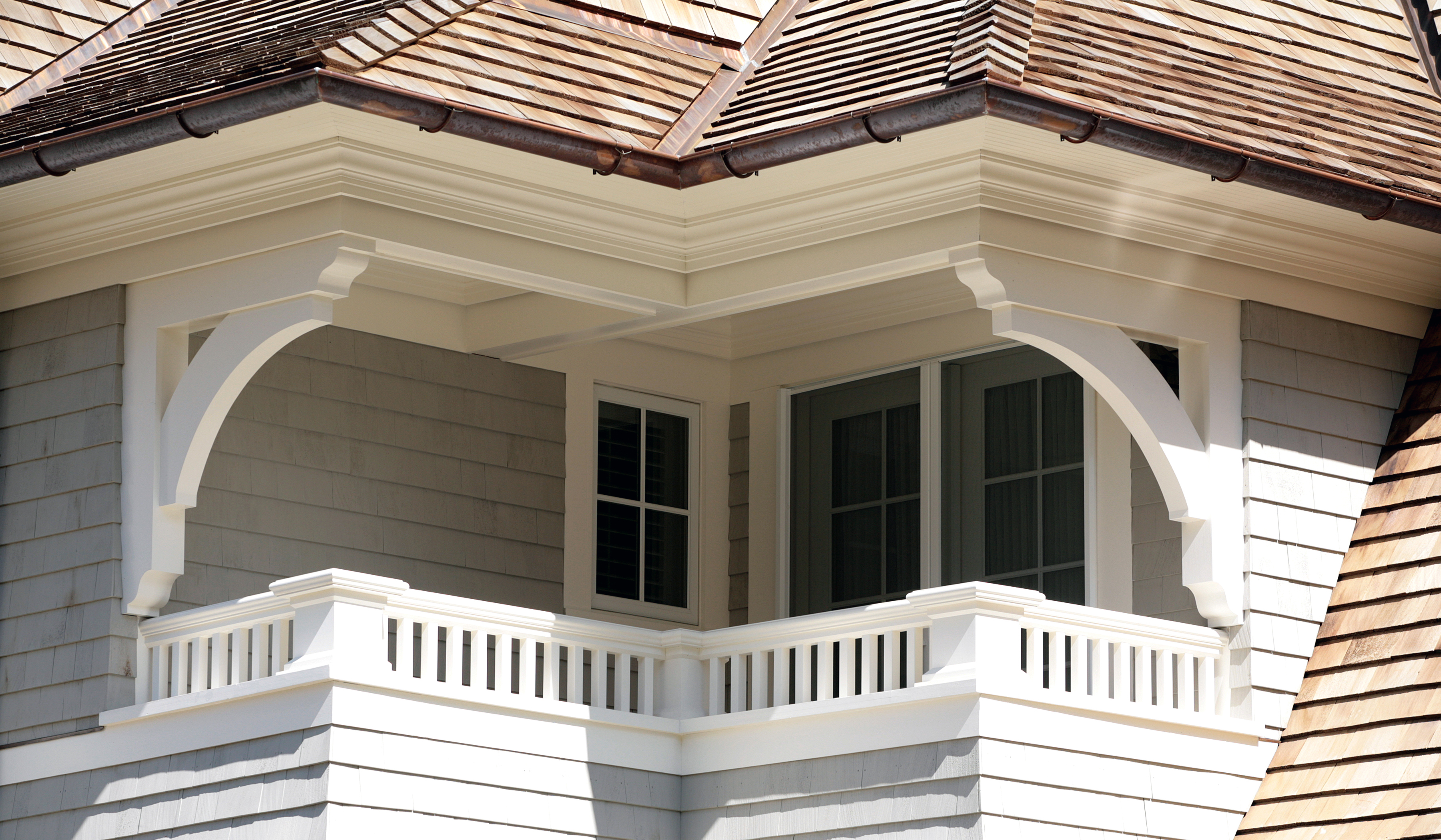 covered balcony in large new england shingle style colonial by cardello architects