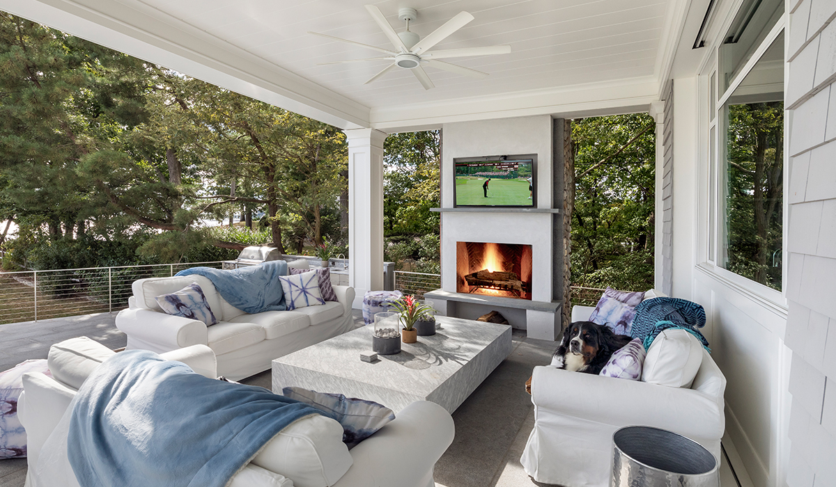 Rowayton connecticut waterfront home with covered terrace adn fireplace overlooking water