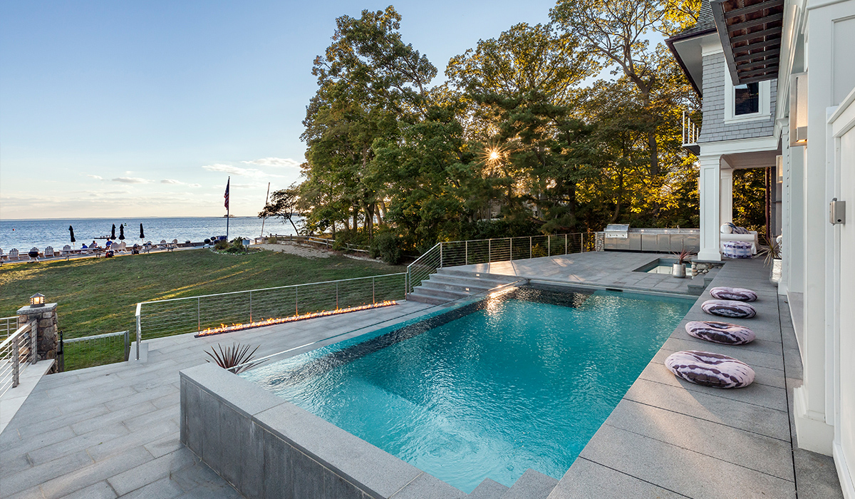 Rowayton connecticut beach house with waterfall edge and firewall
