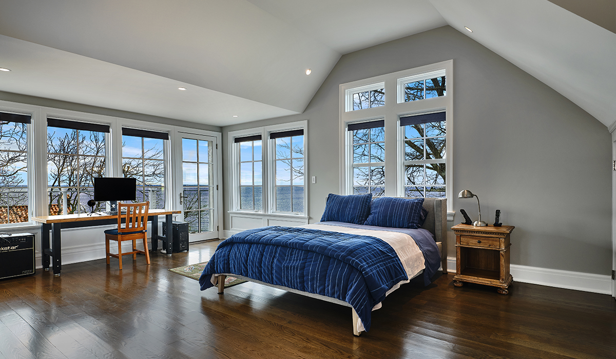 Bedroom with balcony in modern waterfront Stamford Connecticut Renovation