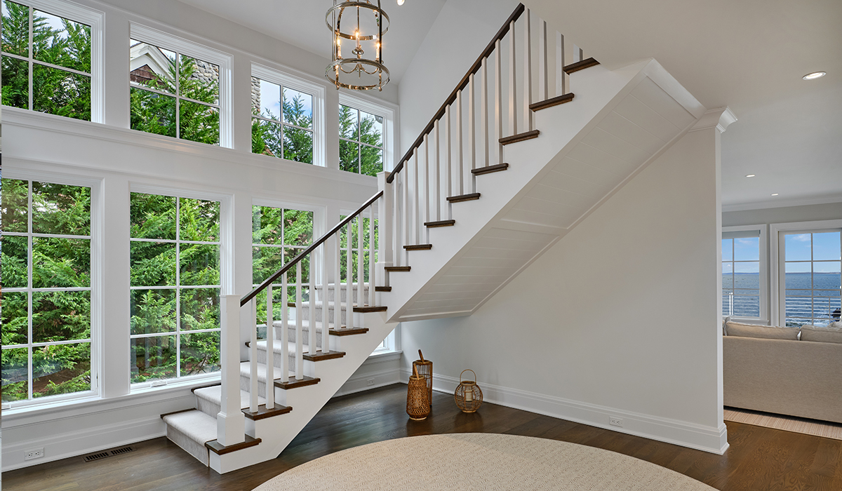 Flaring stair in modern waterfront renovation