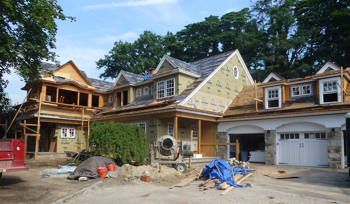 Shingle Style Home Under Construction of custom Home