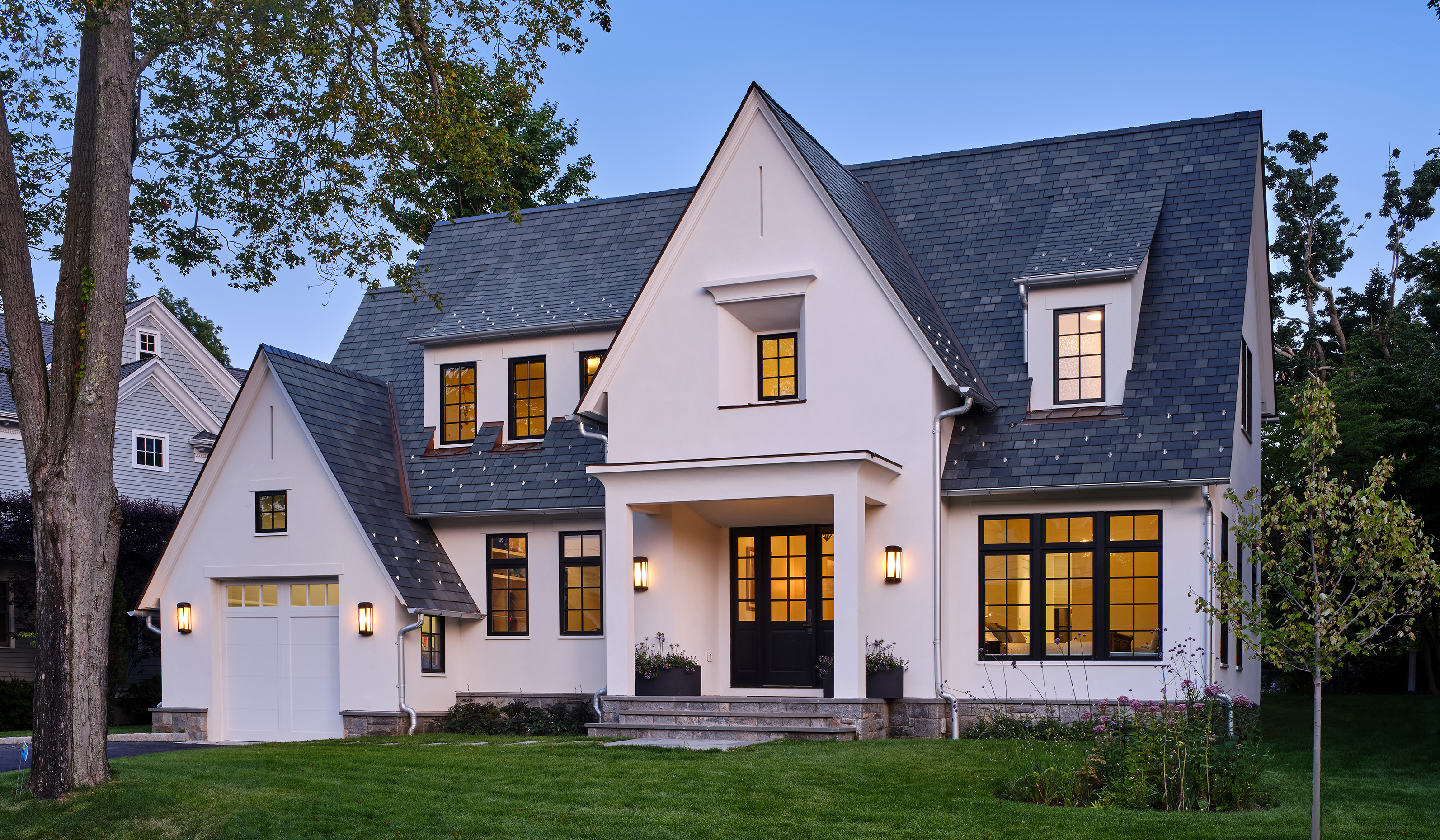Larchmont NY custom stucco cottage exterior by fairfield county luxury custom architect