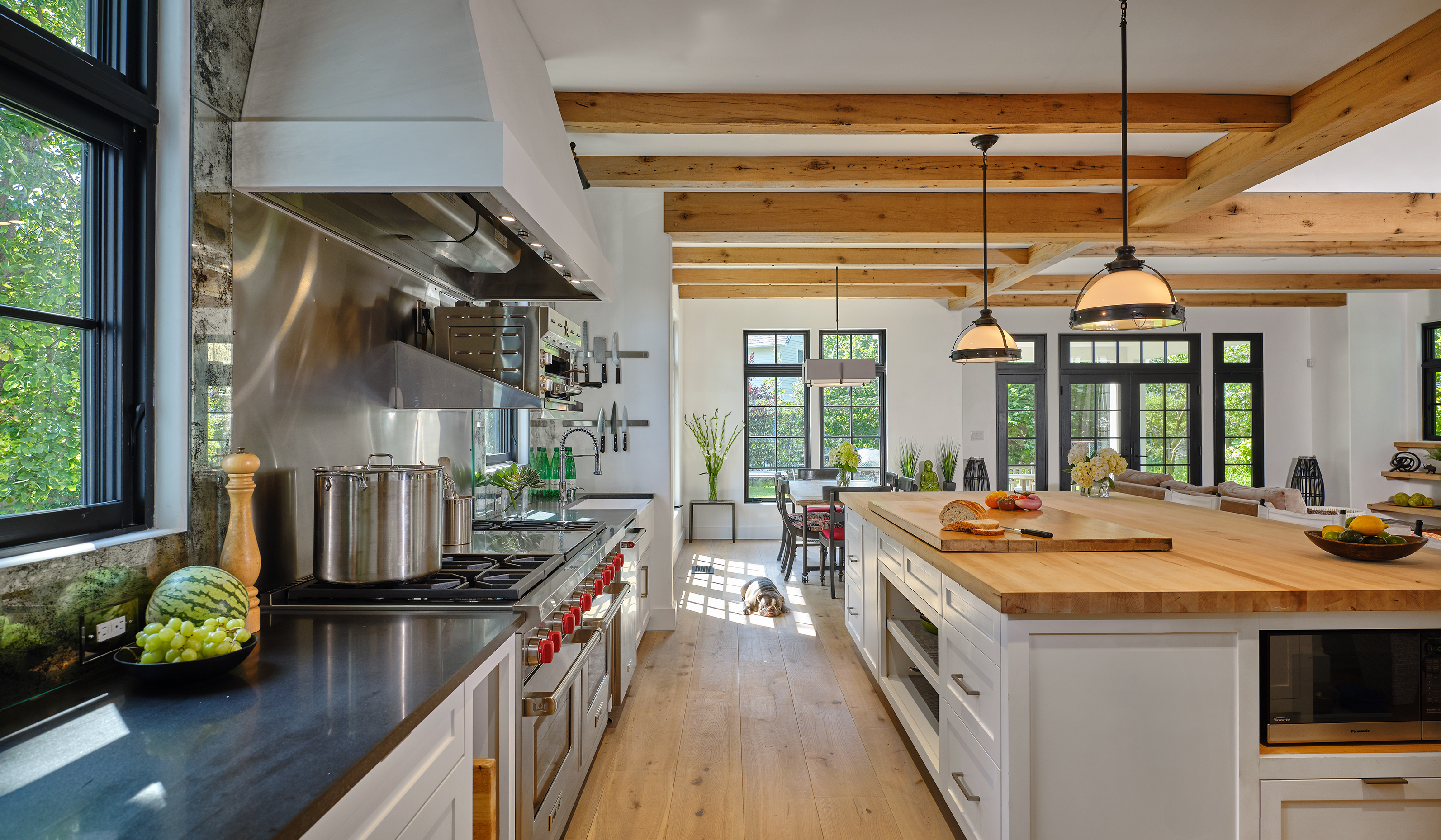 Larchmont NY custom stucco cottage kitchen with wood coffers and custom designed mill-work by luxury architect