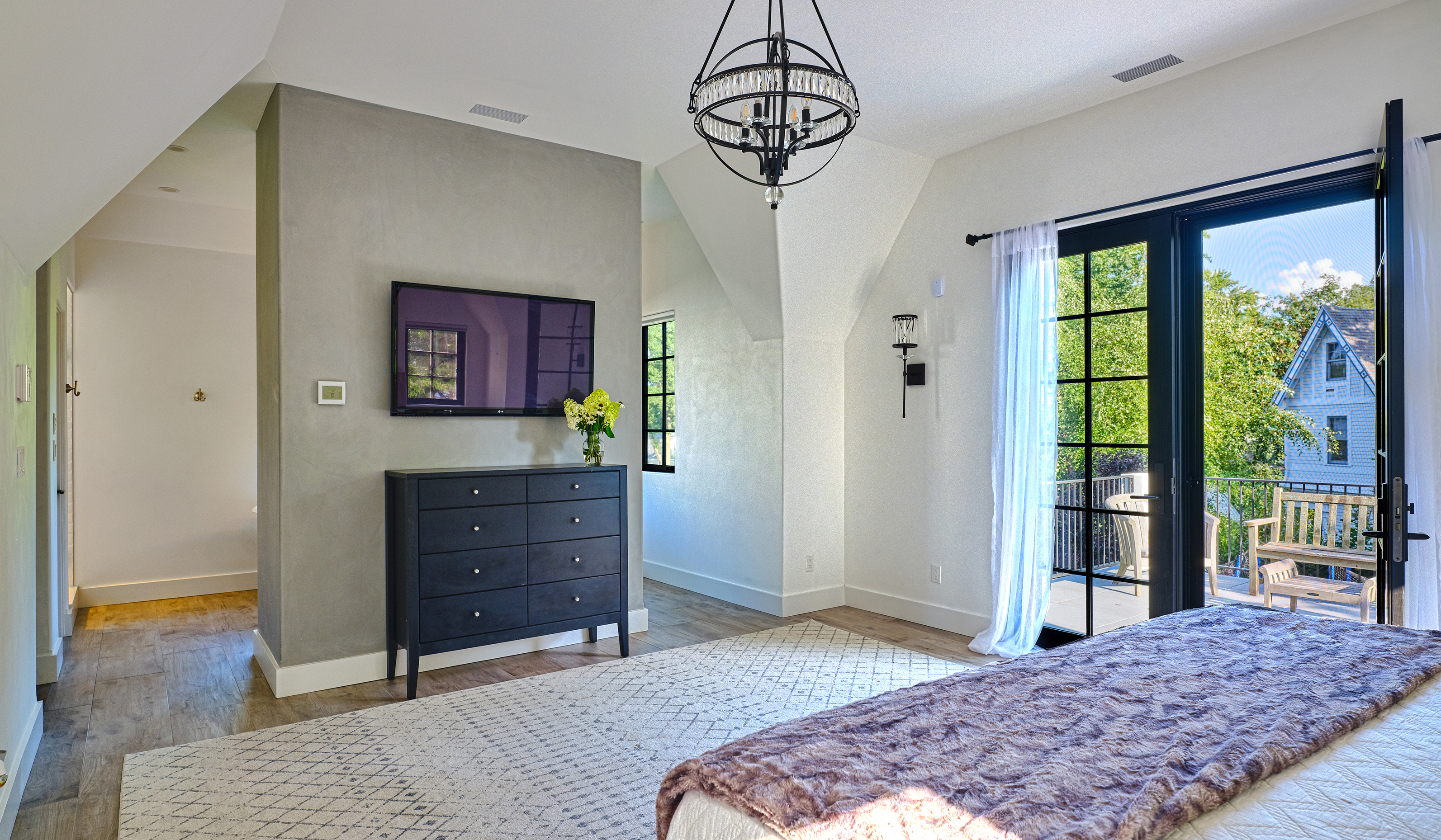 Larchmont NY custom stucco cottage master bedroom with a view and partition wall