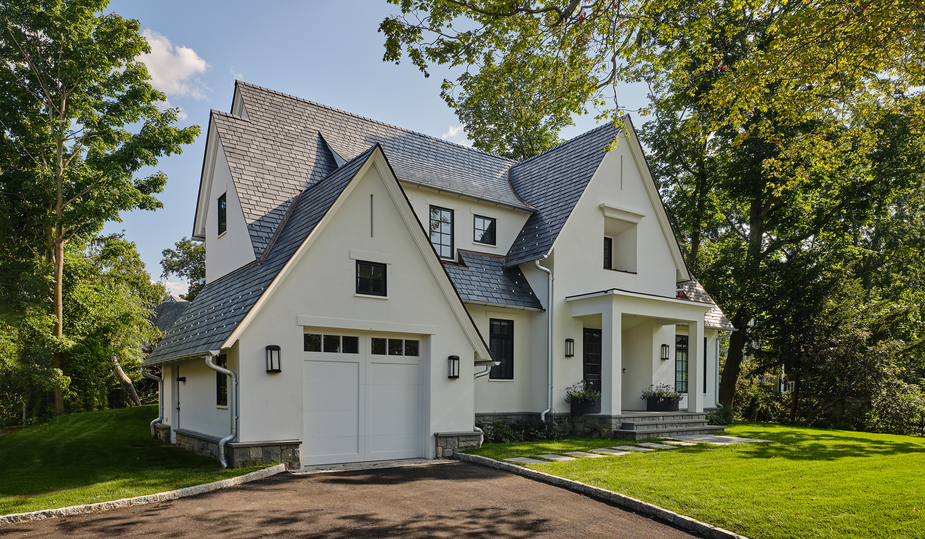 Larchmont NY custom stucco cottage perspective exterior design of white stucco and synthetic slate roof