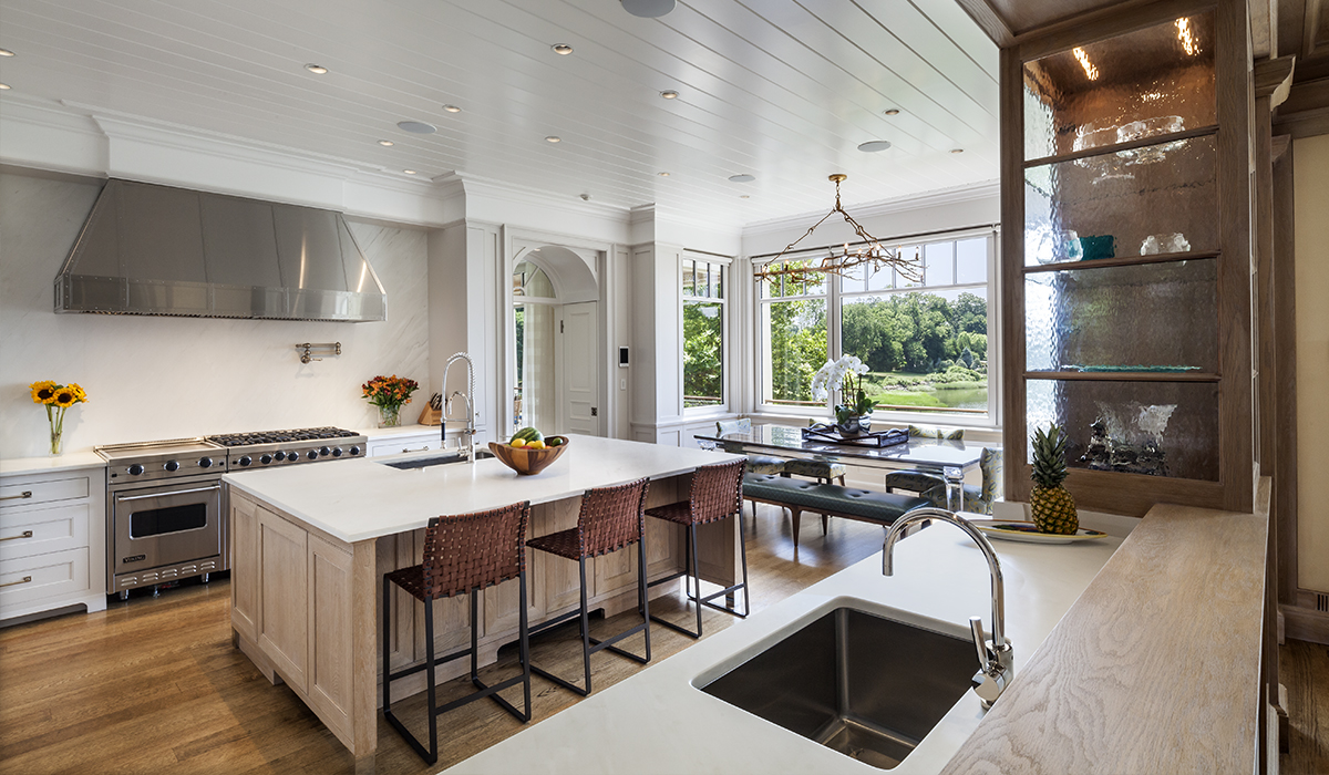 Custom home renovation with open floor plan and waterfront views