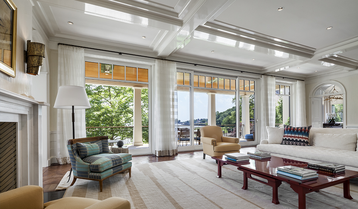 Open floor plan custom home interior renovation with coffered ceilings