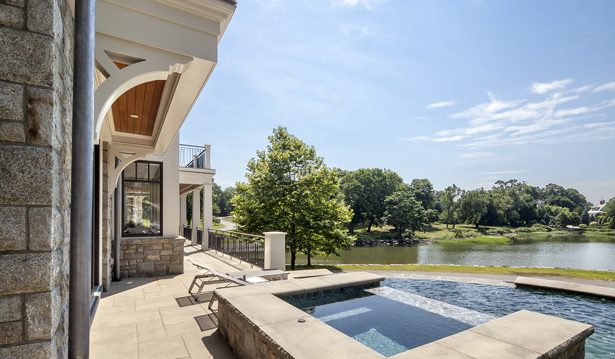 custom home design of luxury million dollar listing with pool terrace and Jacuzzi