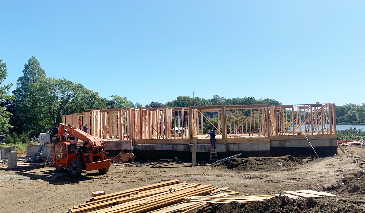 Mill Pond Butterfly new home under construction first floor framing by luxury award winning waterfront architect