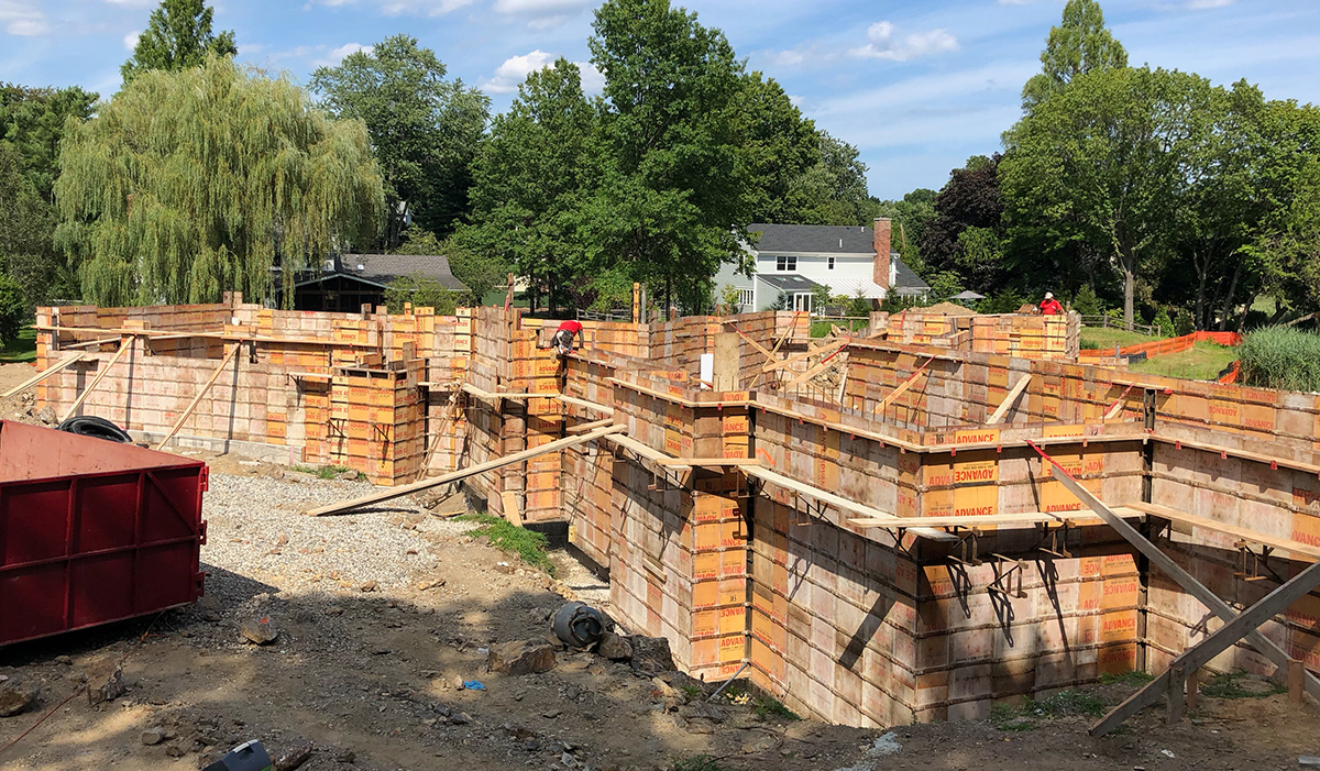 Mill Pond Butterfly new home under construction by luxury custom waterfront architect