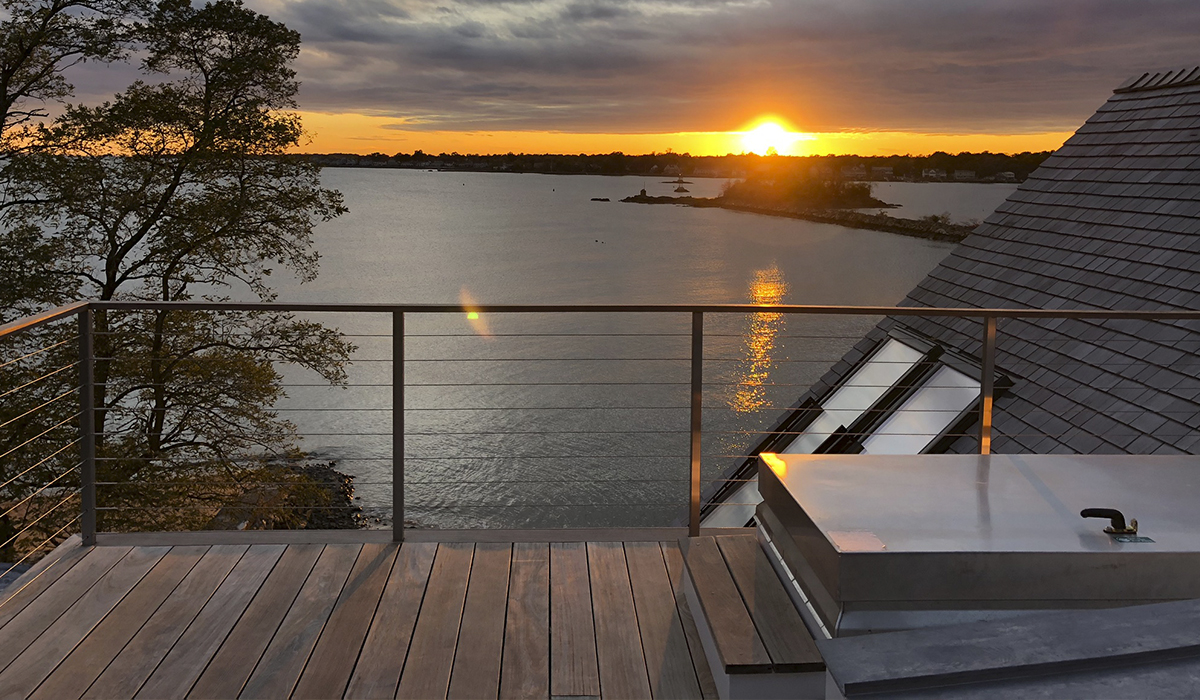 rooftop balcony with a view of waterfront sunset perfect ambiance sunset